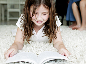 Girl with Book on Carpet